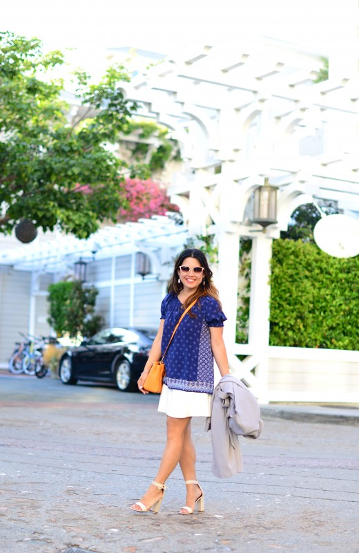 Joie Masha E navy blue border print peasant top and Zara white elastic waist skirt and Coach Madison Mini Christie carryall crossbody bright mandarin and Tibi block heel sandal and Oliver Peoples Annaliesse sunglasses