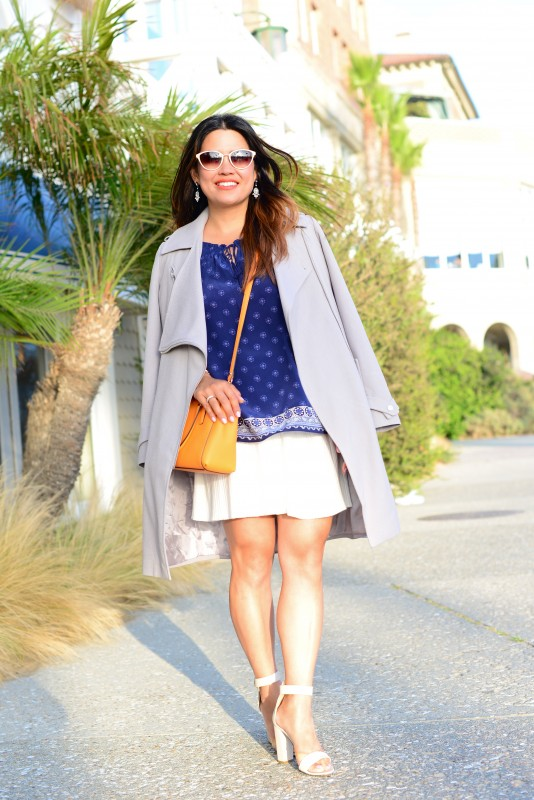 Joie Masha E navy blue border print peasant top and ASOS light grey trench coat and Coach Madison Mini Christie carryall crossbody saffiano bright mandarin and Oliver Peoples Annaliesse sunglasses ivory and Tibi block heel ankle strap sandal