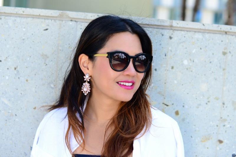 Thierry Lasry magnety black sunglasses and pink crystal earrings hot pink lipstick