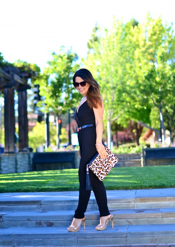 Black jumpsuit metallic sandals and leopard clutch