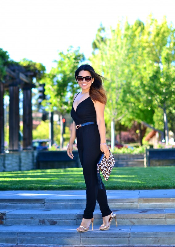 Stylish jumpsuit and leopard clutch