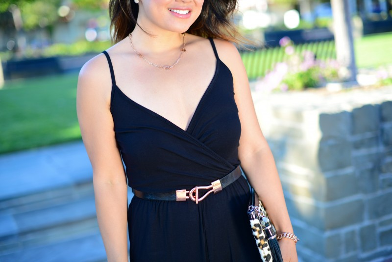 Black jumpsuit and rose gold accessories