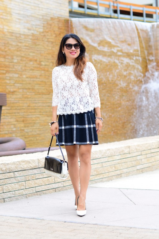 Black and white outfit in a lace top and fit and flared plaid skirt
