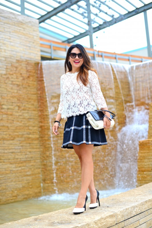 Black and white chic in lace top and check print flared skirt