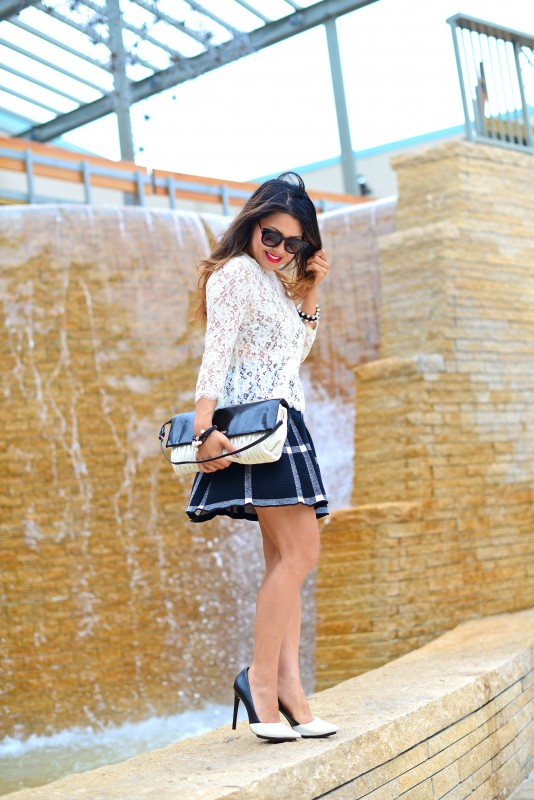 Black and white skirt outfit in lace top and flared grid skirt and Miu Miu shoulder bag