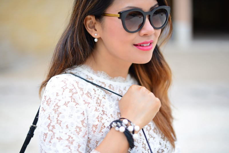 Double pearl earring and bracelet and Thierry Lasry round black sunglasses