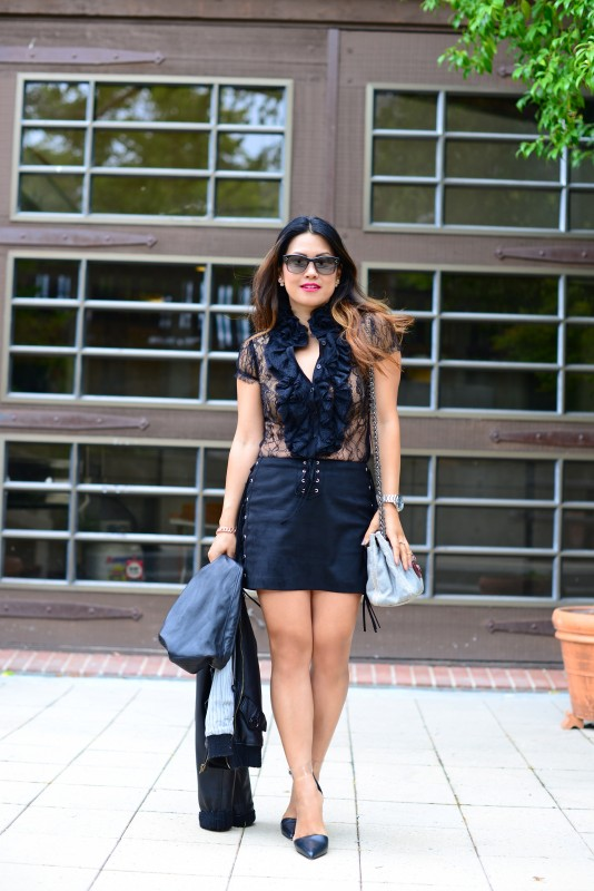Sexy edgy black outfit in lace bib shirt and fringe suede mini skirt
