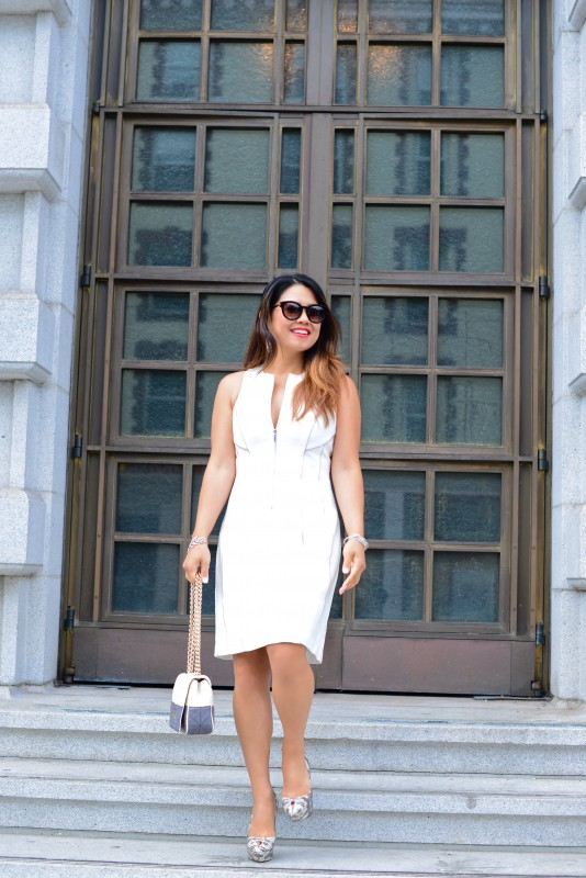 Classy look white sheath dress and snakeskin pumps