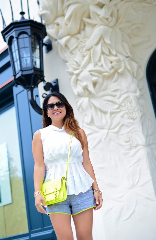 Shorts outfit peplum top tweed shorts and neon crossbody bag
