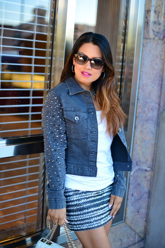 edgy spikes denim jacket and tweed skirt