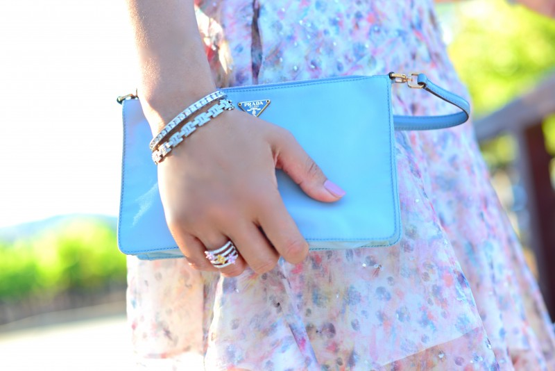 Vintage Prada clutch and diamond bracelets and ring