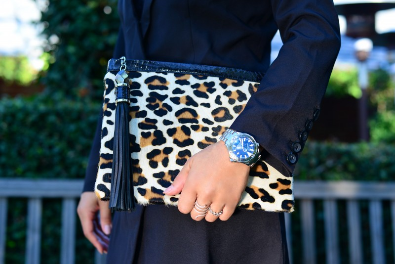 leopard clutch and omega watch