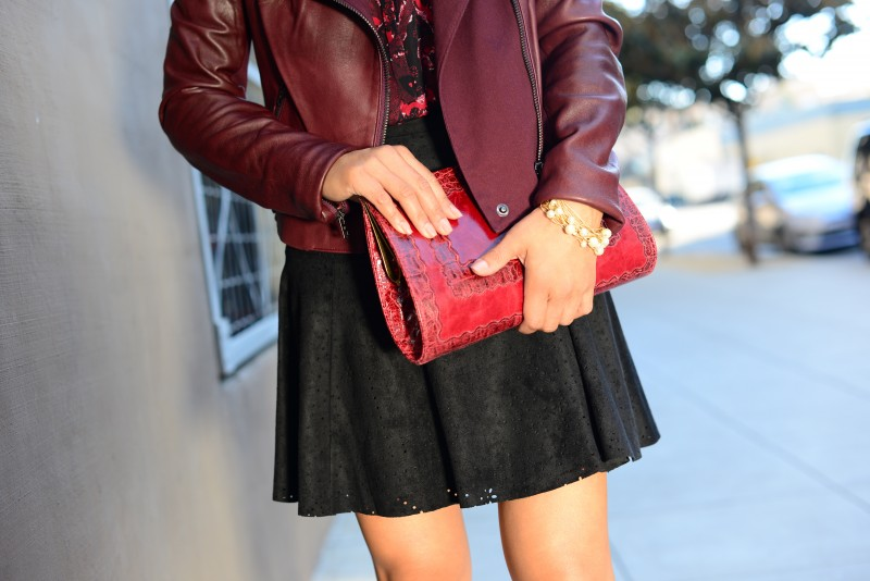Wine clutch and burgundy leather jacket