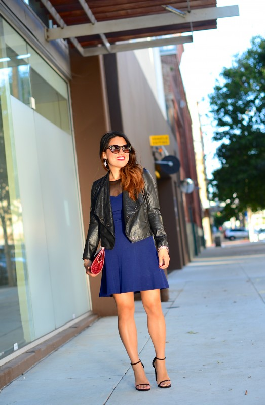 Evening outfit blue cocktail dress and leather jacket