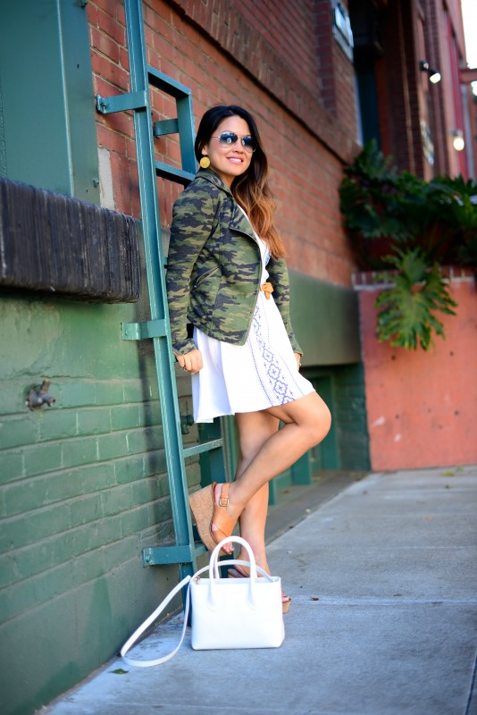 Camo moto jacket and white dress