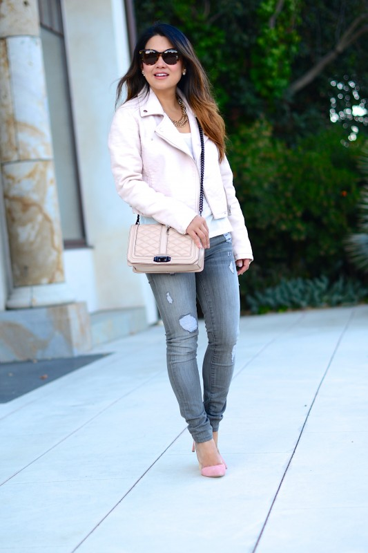 Pink leather jacket and distressed grey jeans