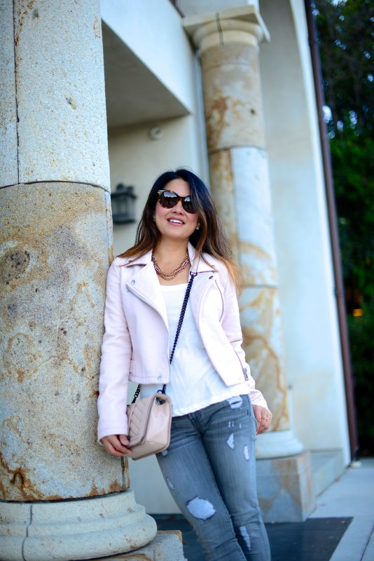Pink faux leather jacket and distressed grey skinny jeans