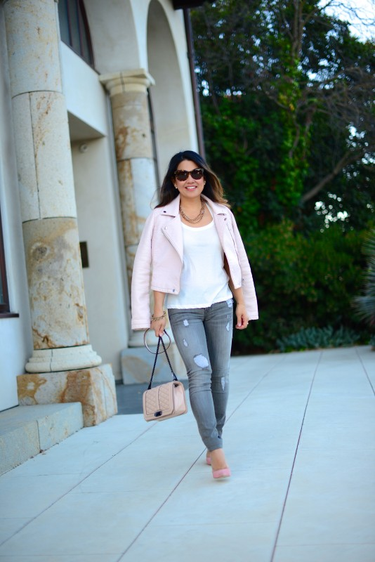 Pale pink jacket and grey distressed skinny jeans