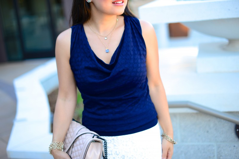 Cowl neck navy sleeveless sweater and layered necklace