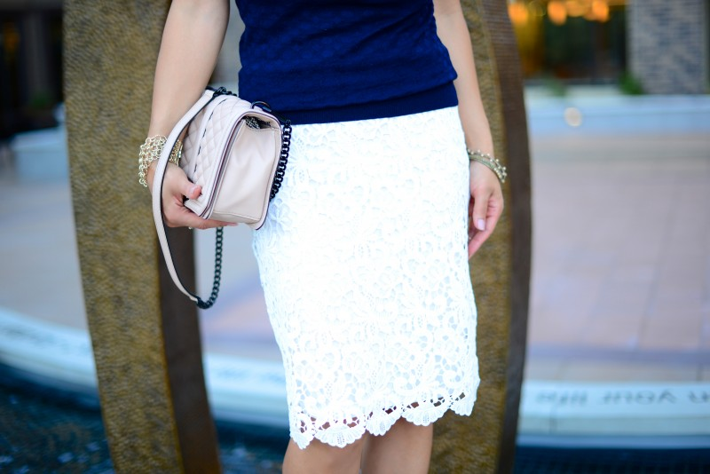 White lace pencil skirt and blush handbag
