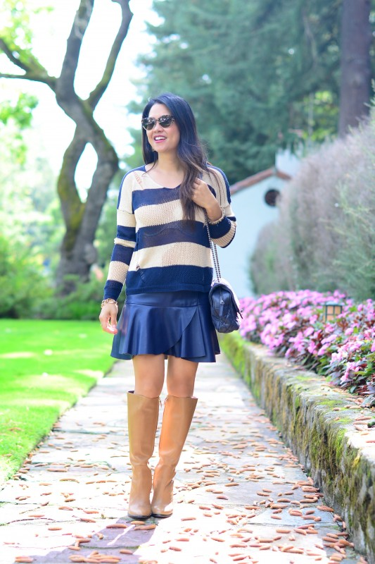 Sweater and faux leather skirt
