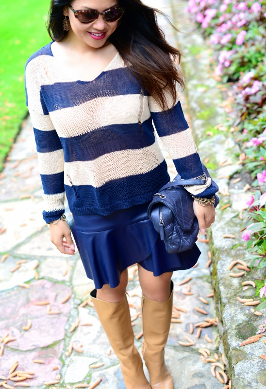 Navy tan stripes sweater and camel knee high boots