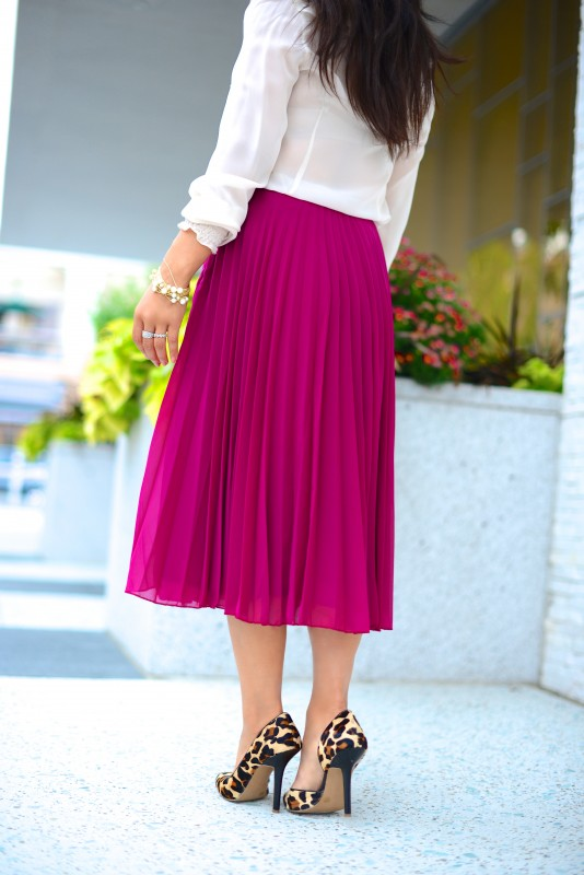 Elegant pleated skirt  silk blouse and leopard heels