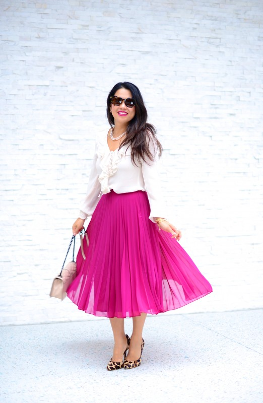 Classy in pleated long skirt and silk blouse