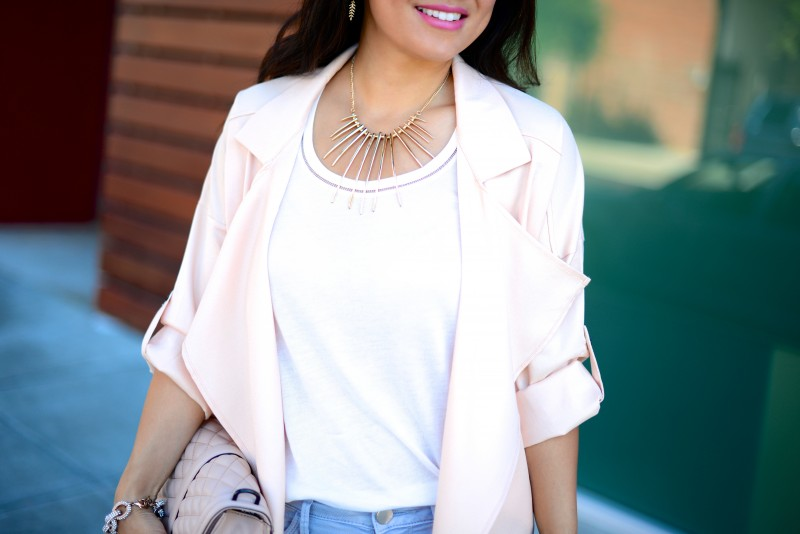Draped pale pink jacket and gold spiked necklace