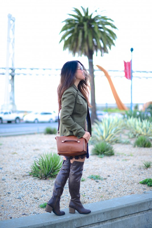 Army coat thigh high boots and brown cross body bag