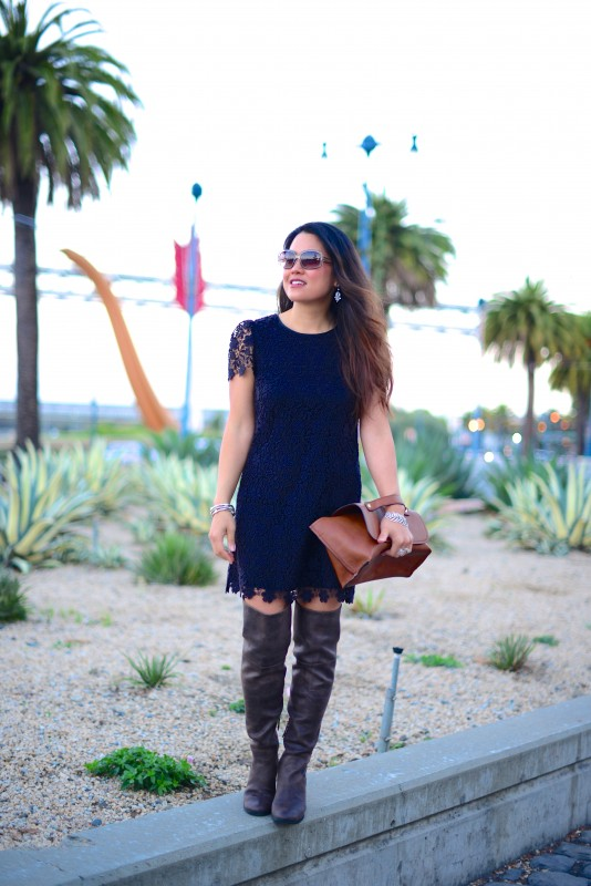 Little black lace dress over the knee boots and brown clutch