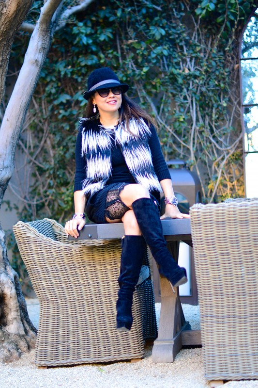 Faux fur vest fedora boots and sassy stash