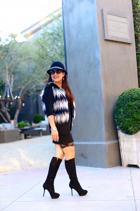 Black and white fur vest sweater dress and fedora