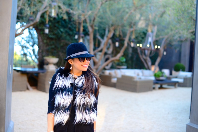 black and white fur vest and fedora