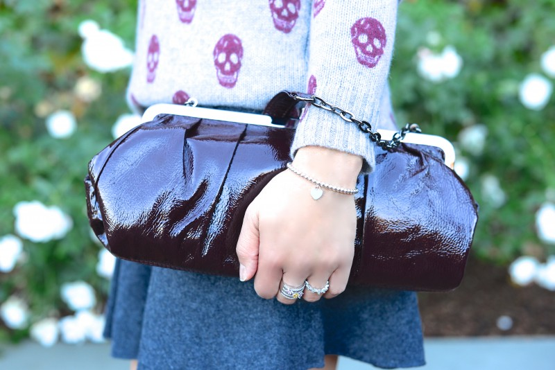 Tiffany Company bracelet and burgundy clutch